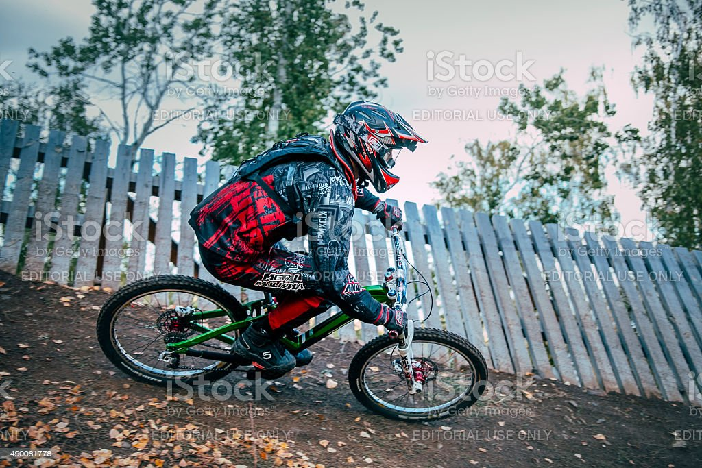 Cyclist riding a mountain bike downhill stock photo