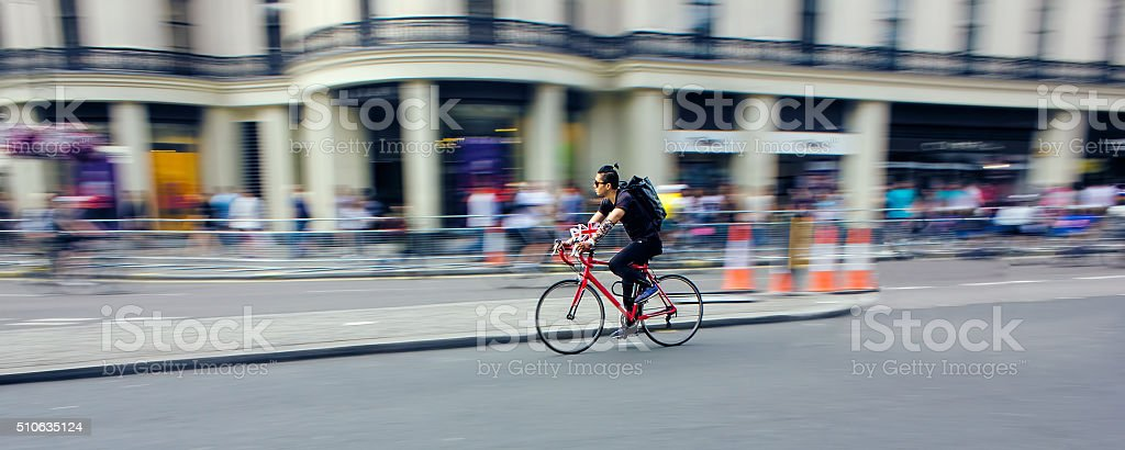 Cyclist Riding Bike Fast Through City. Speed Blur stock photo