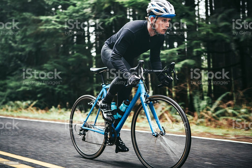 Cyclist Riding Mountain Road stock photo