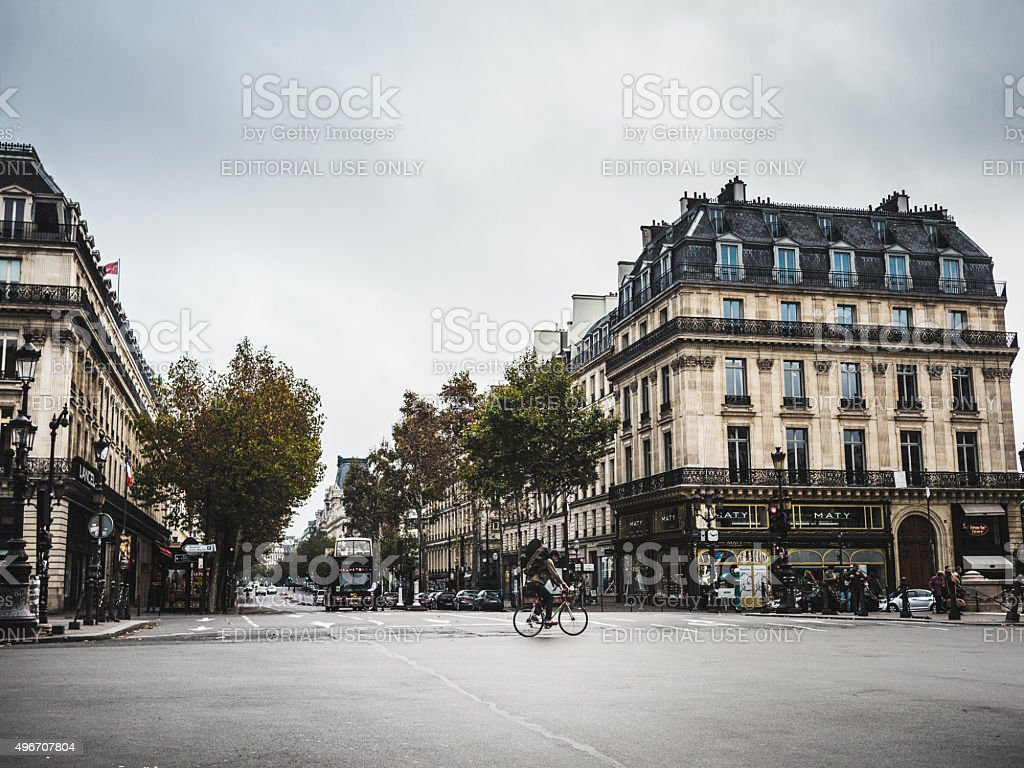 Cyclist riding over the Opera square in Paris stock photo