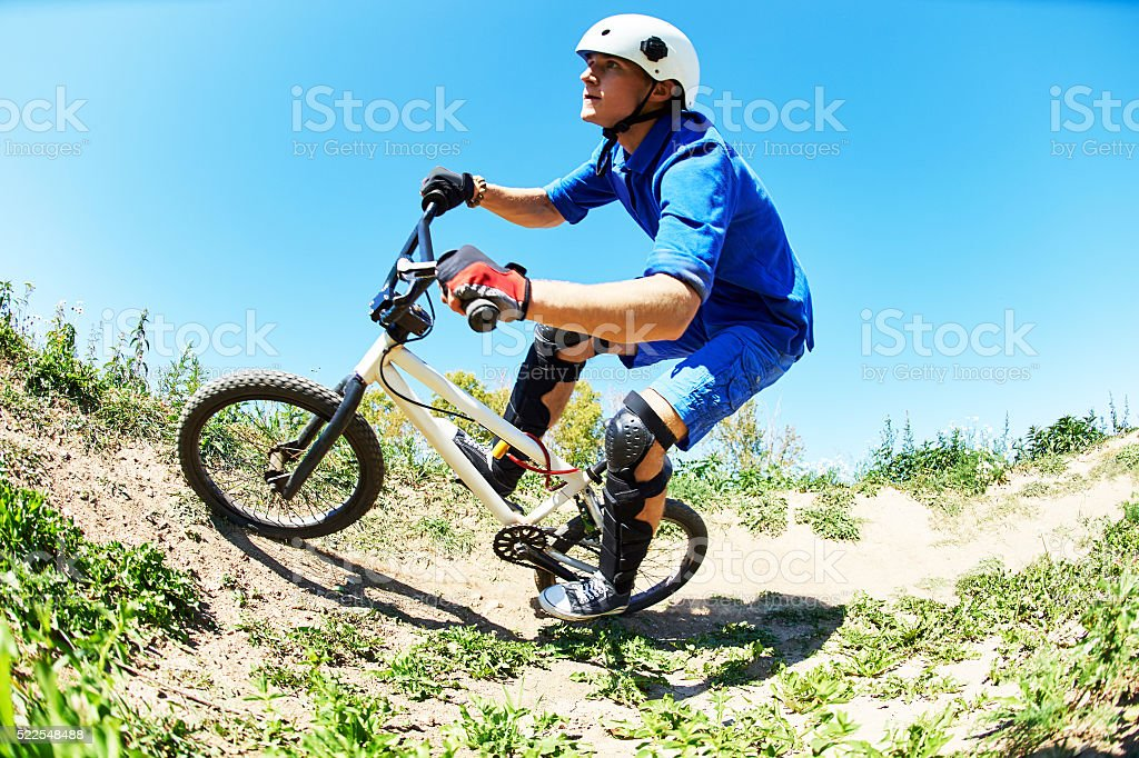 cyclist riding the bike downhill stock photo