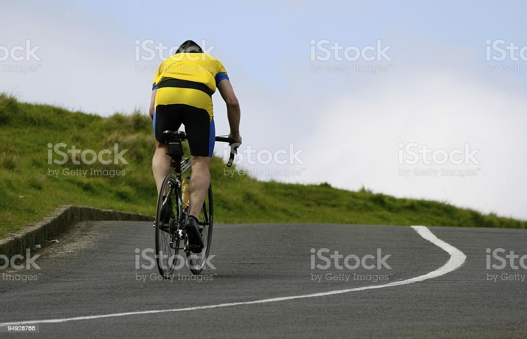Cyclist riding uphill stock photo