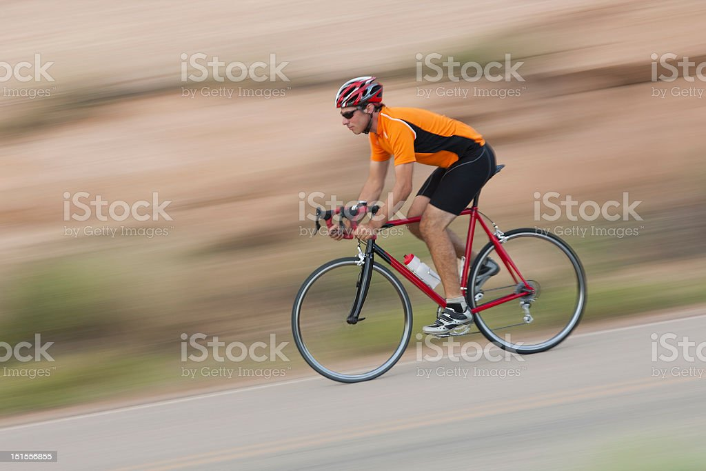 Cyclist Speeding Downhill On Slickrock Trail In Moab, Utah royalty-free stock photo
