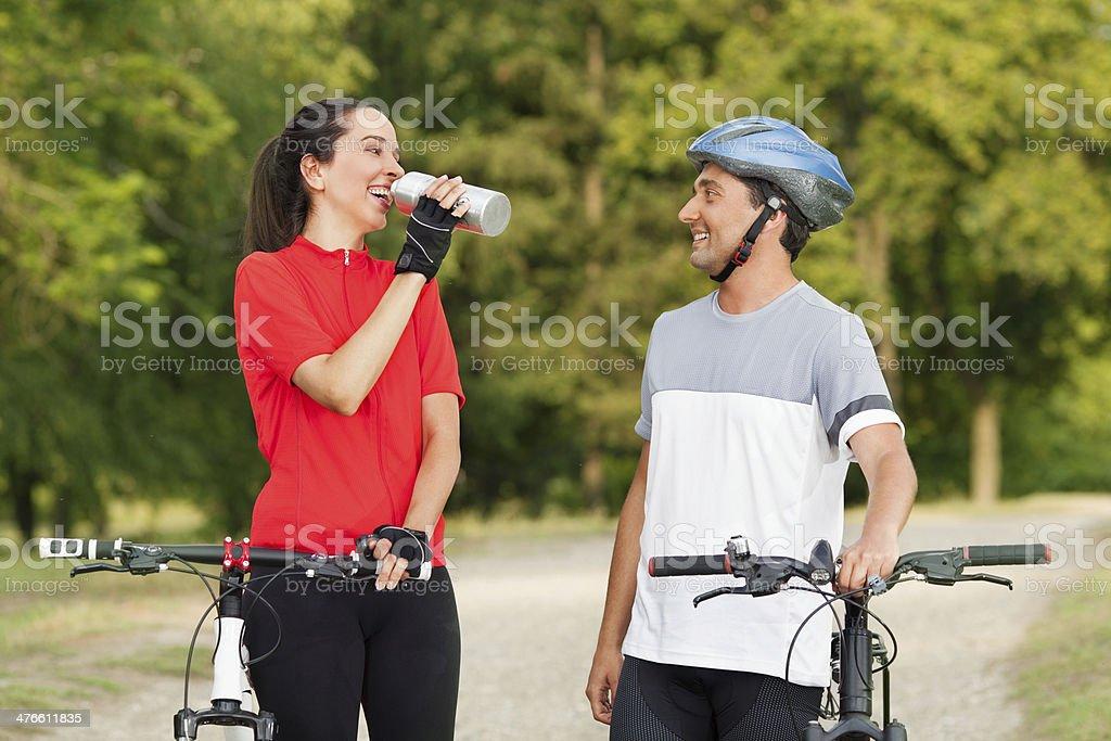 Cyclist takes a water break royalty-free stock photo