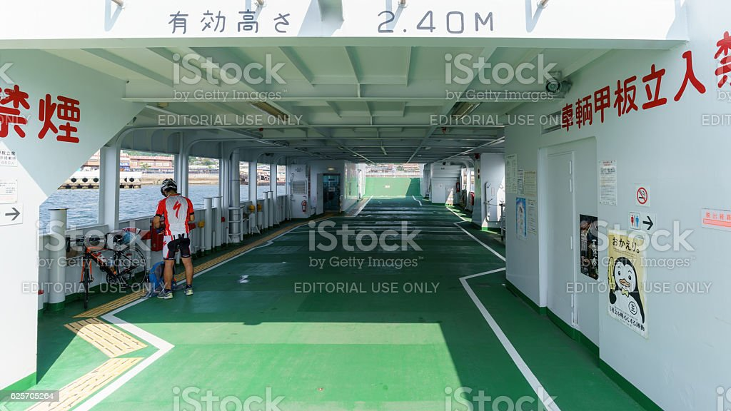 Cyclist taking ferry stock photo