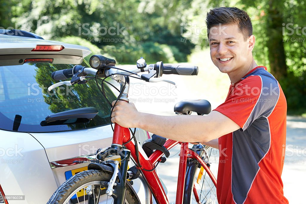 Cyclist Taking Mountain Bike From Rack On Car stock photo