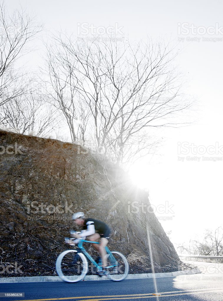 Cyclist training on a mountain road royalty-free stock photo