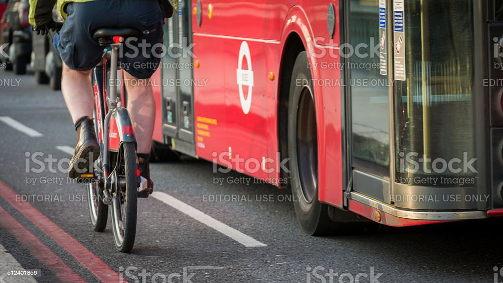 Cyclist using the Santander Bicycle Hire Scheme in London stock photo