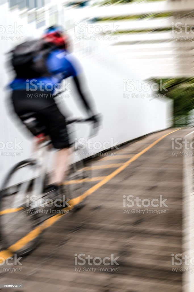 Cyclist very fast riding stock photo