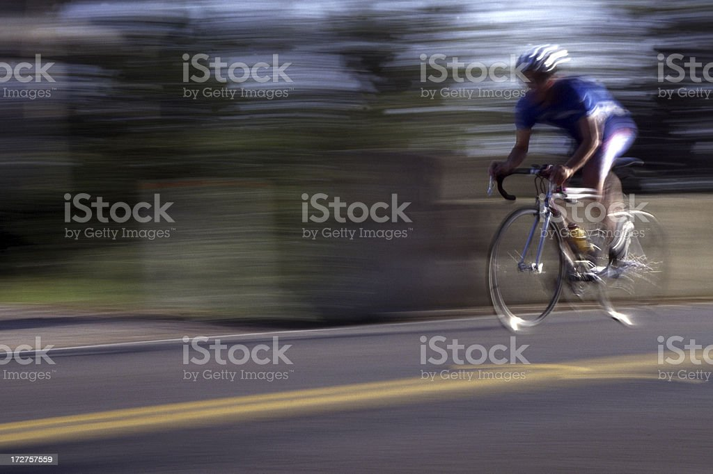 Cyclist whizzing by royalty-free stock photo