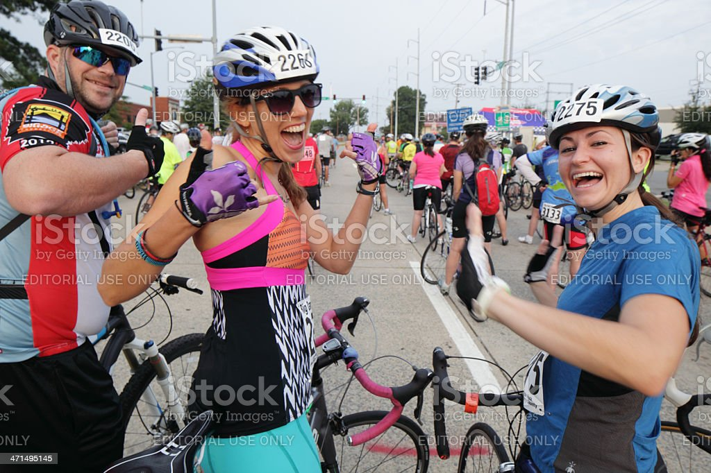 Cyclists anticipating the start of a fundraising bicycle ride stock photo