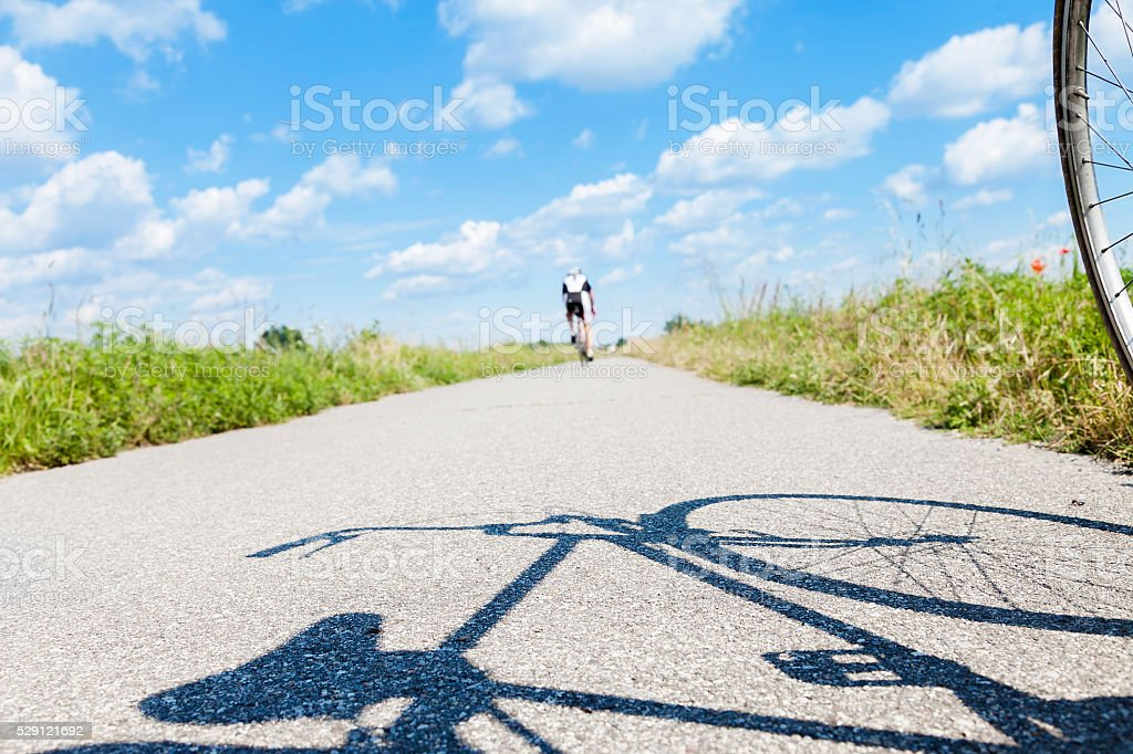 cyclists are training on a country road stock photo