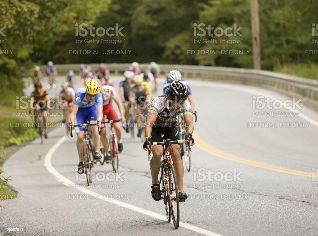 Cyclists Climbing aSteep Hill stock photo