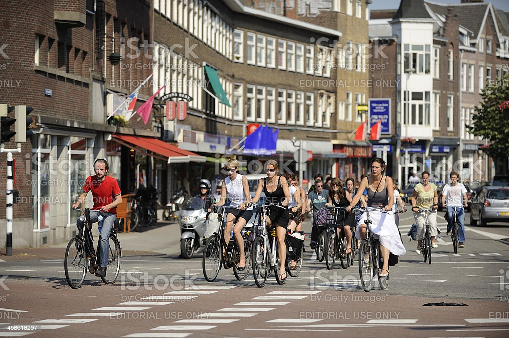 Cyclists crossing an intersection in Utrecht the Netherlands royalty-free stock photo
