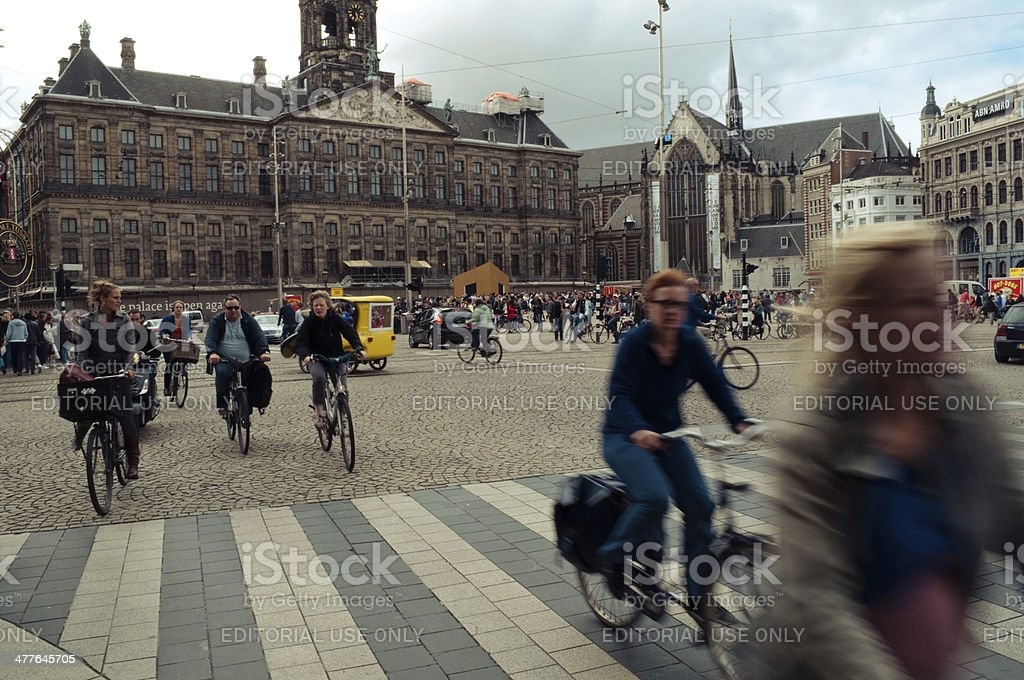 Cyclists in Dam square royalty-free stock photo
