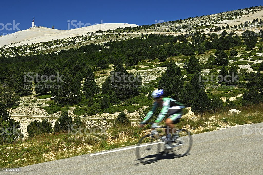 Cyclists on a down hill race stock photo