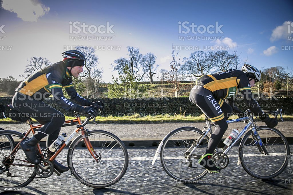 cyclists on Yorkshire country road royalty-free stock photo