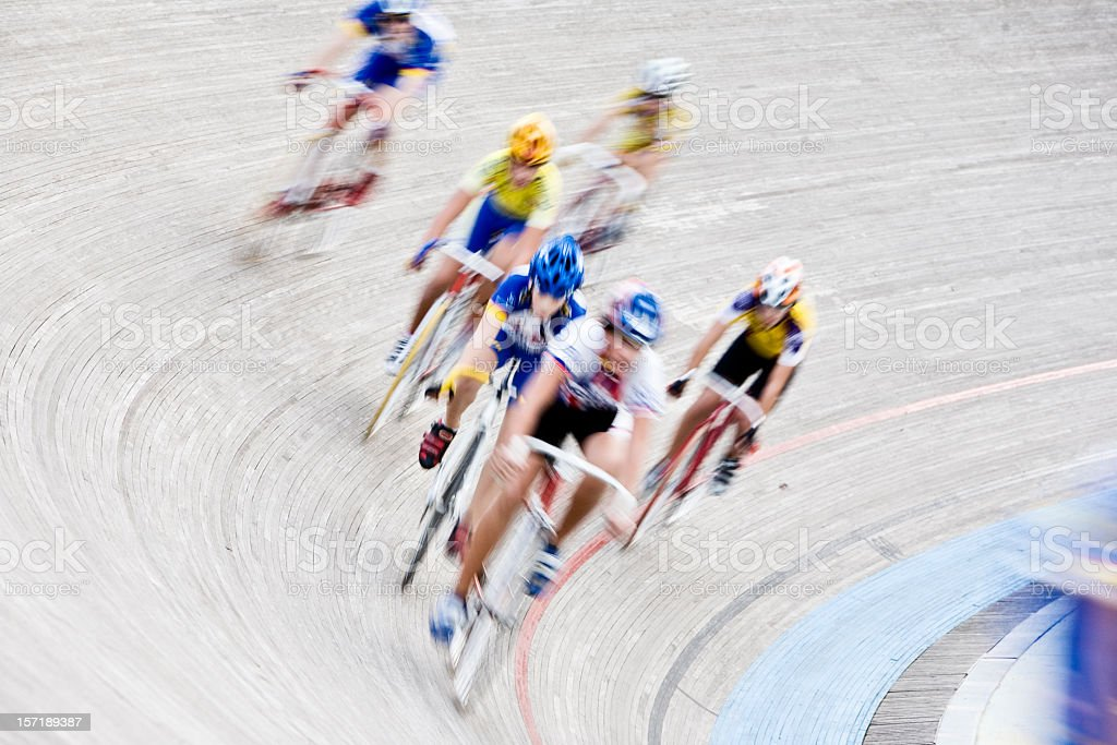 Cyclists racing around a circuit in a velodrome stock photo