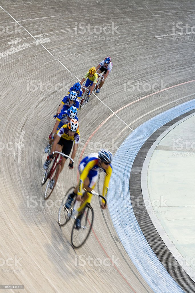 cyclists racing in bicycle velodrom stock photo