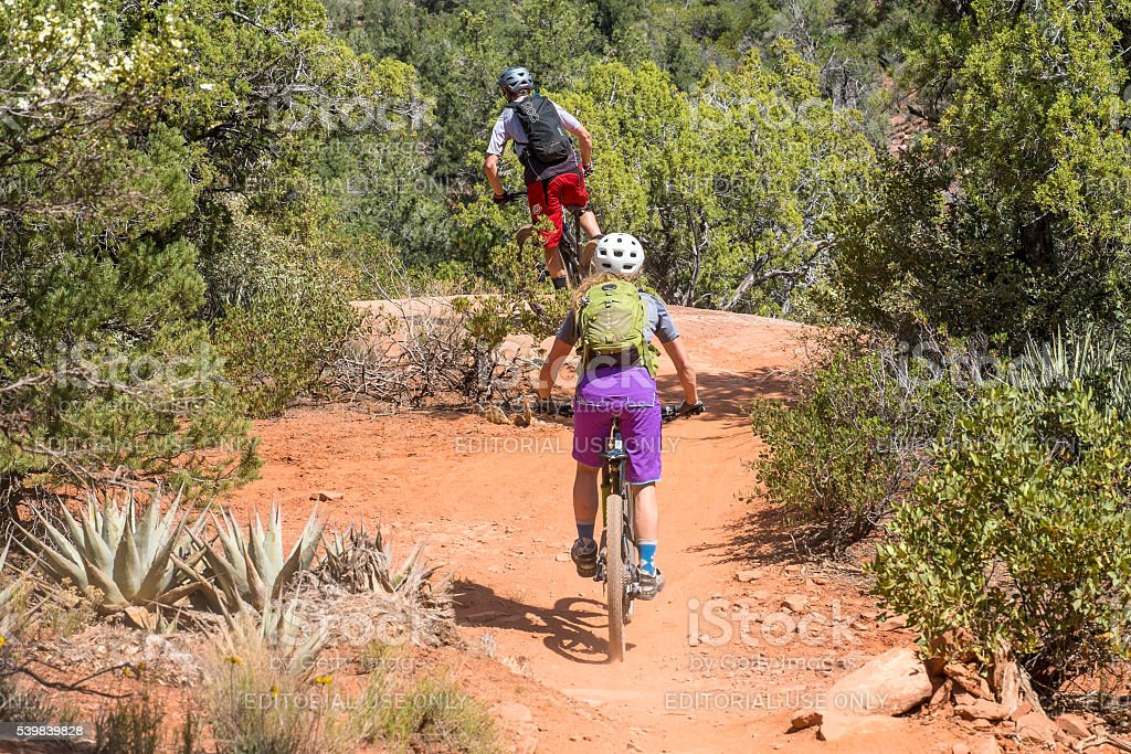 Cyclists Riding in a Scenic Trail in Arizona USA stock photo