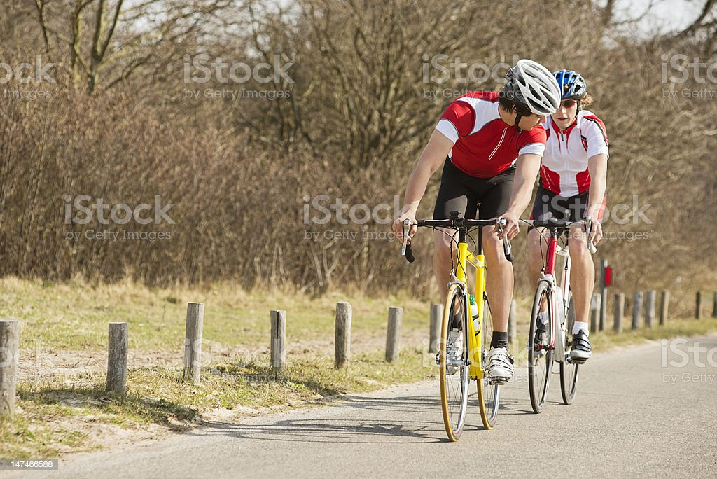 Cyclists Riding On Country Road royalty-free stock photo