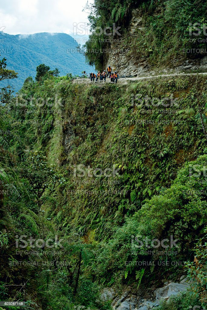 Cyclists sitting down on the Death Road, North Yungas, Bolivia. stock photo