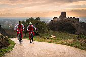 Cyclists train on the hills surrounding the castle of Soave.