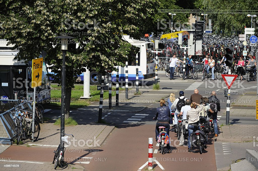 Cyclists waiting at red traffic light in Utrecht royalty-free stock photo
