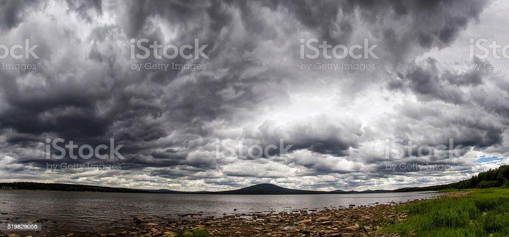 Cyclone on a mountain lake stock photo