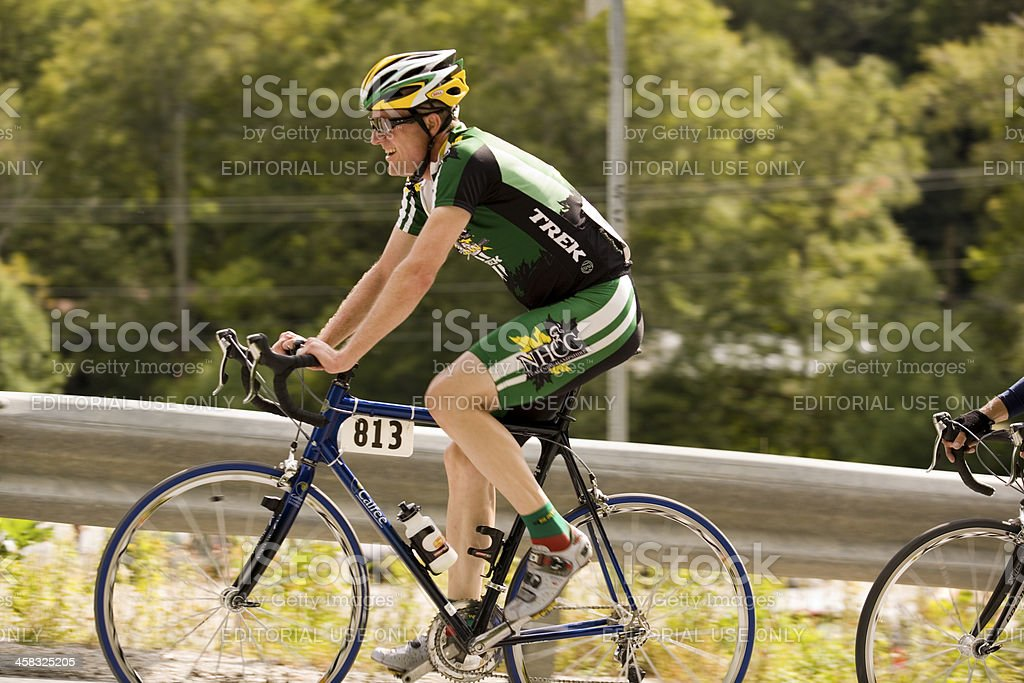 Cyclyst Exerting on a Steep Climg stock photo