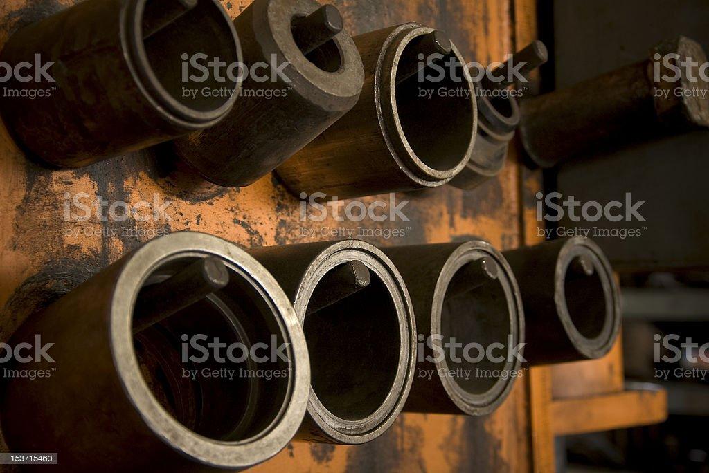 Cylinder Molds on Storage Rack stock photo