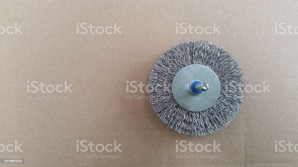 cylindrical metal brush for rotating machine stock photo