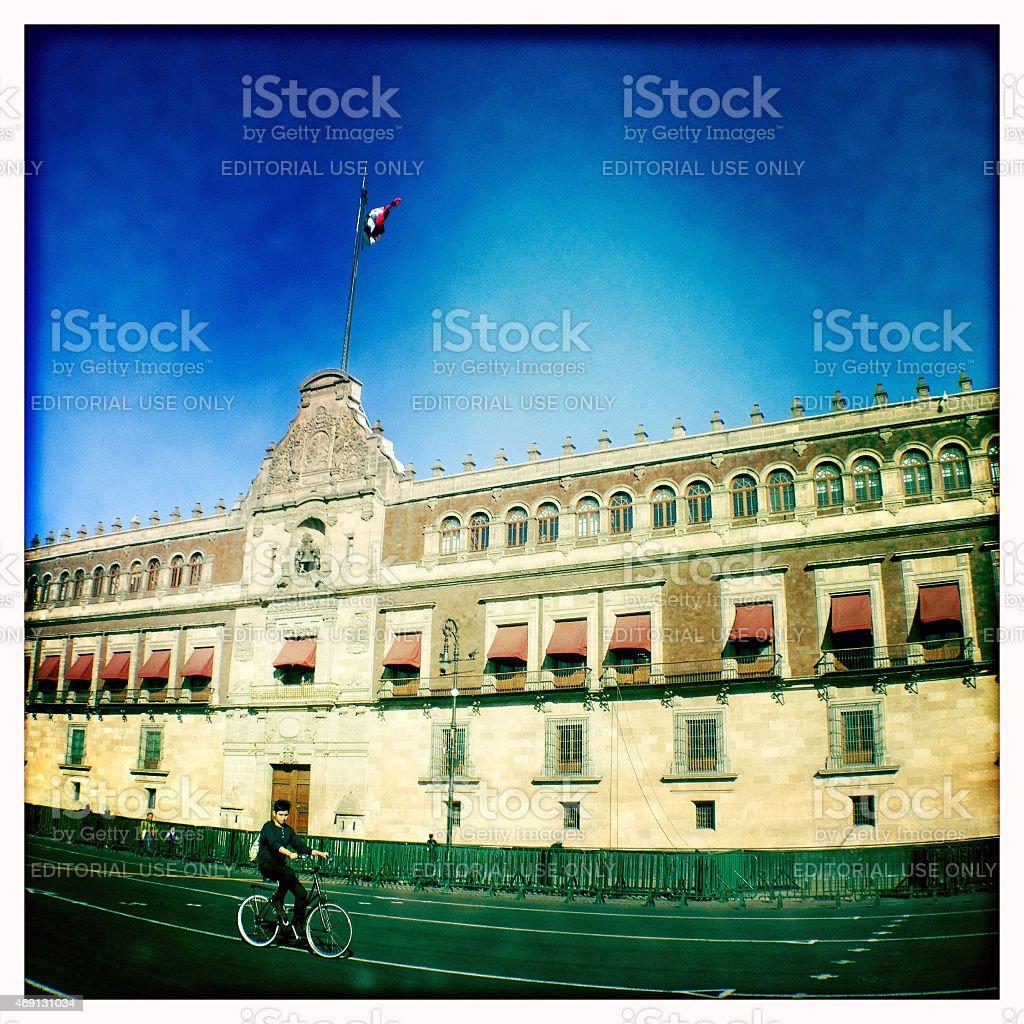 Cylist in fron of Palacio Nacional, Mexico City stock photo