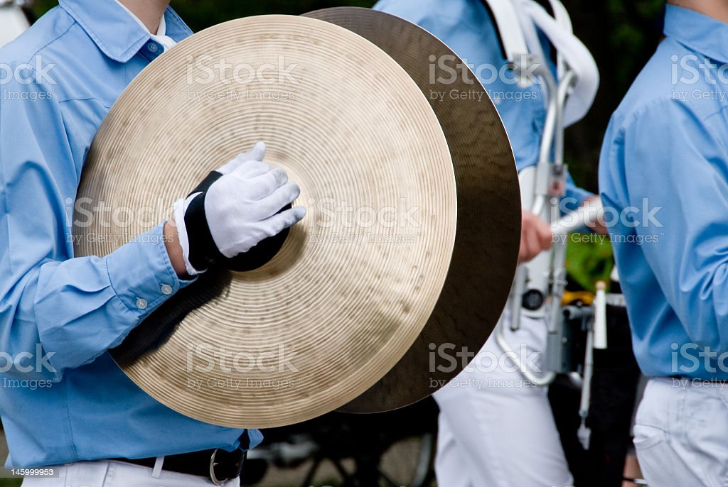 Cymbal player in a marching band stock photo