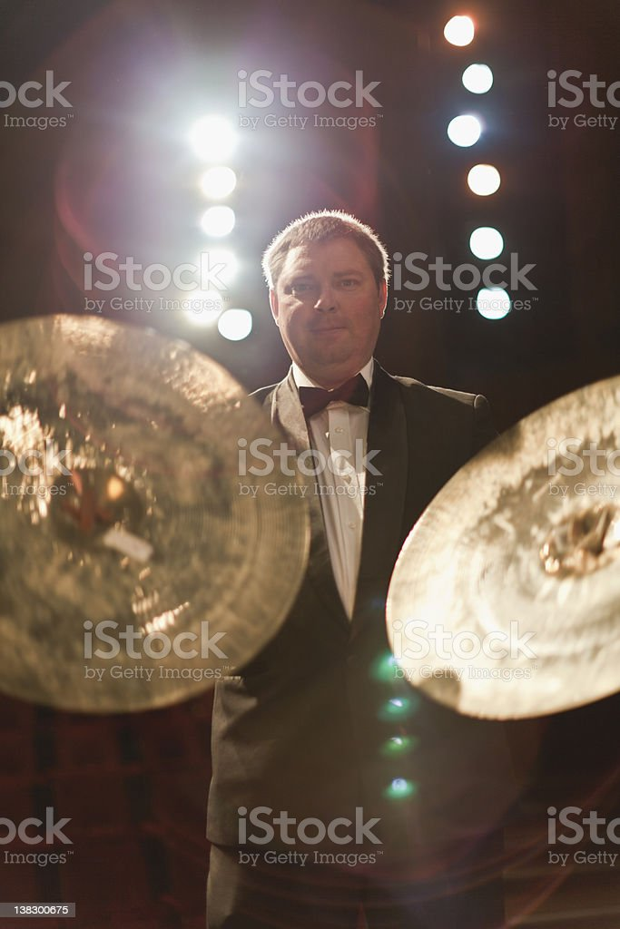 Cymbals player in orchestra stock photo