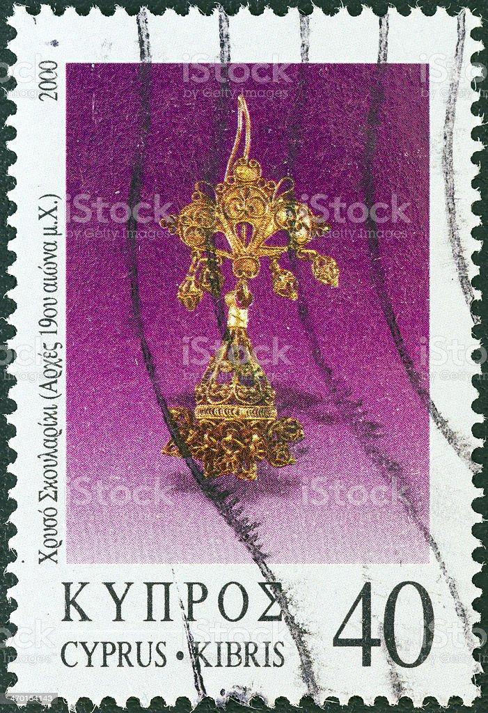 Cypriot stamp shows a golden earring (2000) royalty-free stock photo