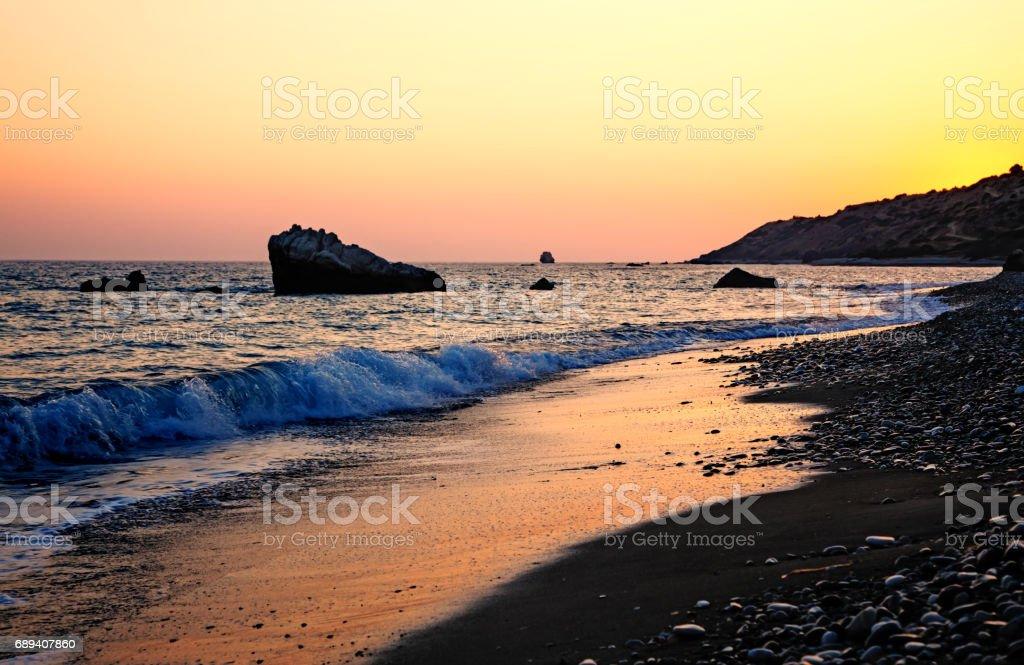 Cyprus coast before sunset near Petra Tou Romiou stock photo