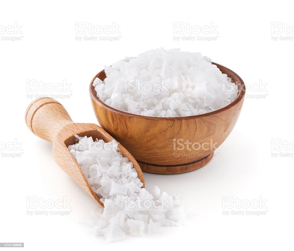 Cyprus sea salt flakes in a wooden bowl stock photo