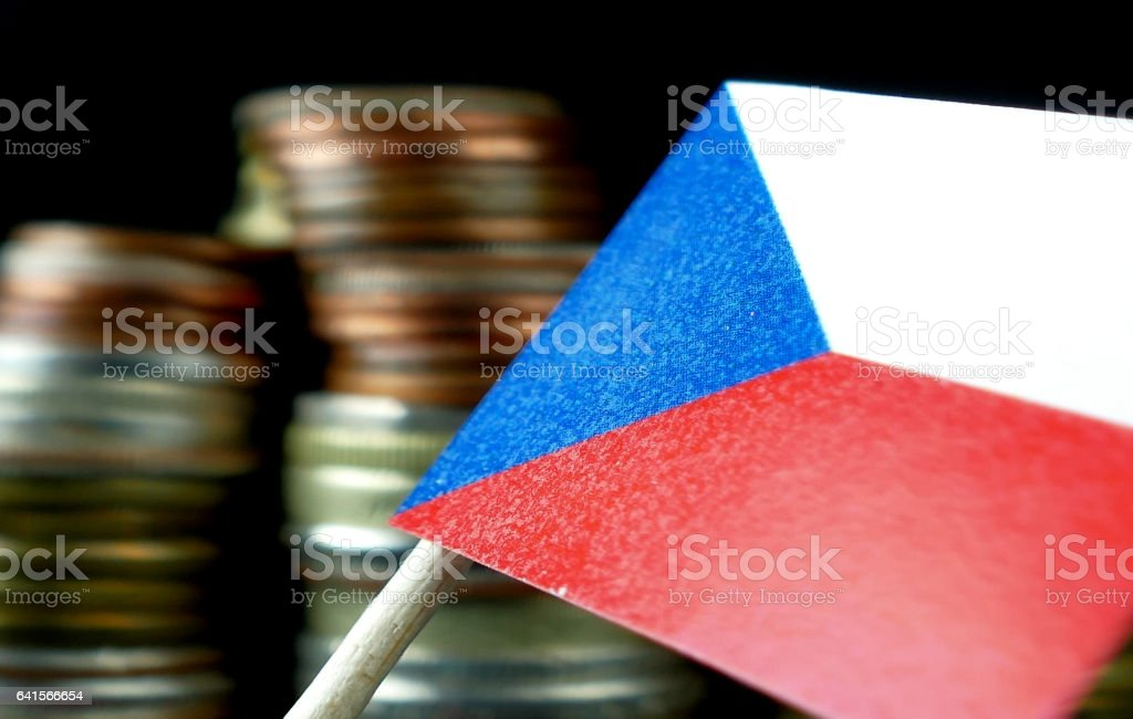 Czech Republic flag waving with stack of money coins macro stock photo