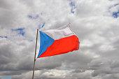 czech republic national flag and cloudy sky