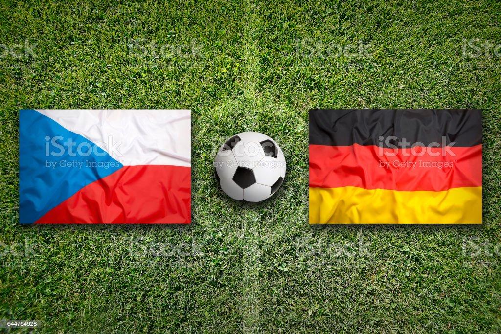 Czech Republic vs. Germany flags on soccer field stock photo