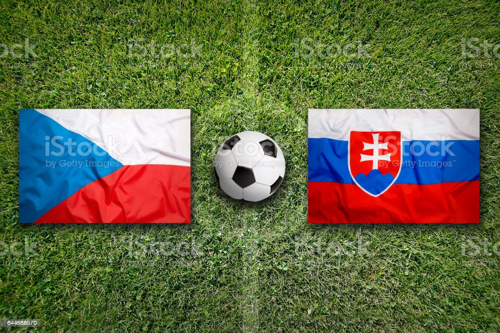 Czech Republic vs. Slovakia flags on soccer field stock photo