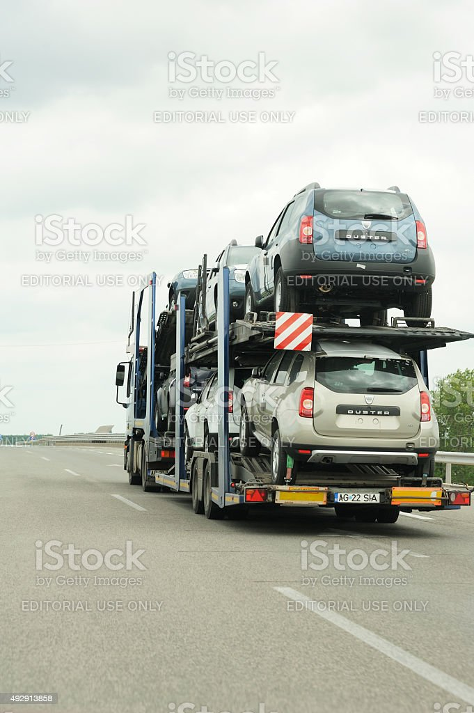 Dacia Duster cars being transported on a Lagermax Trailer stock photo