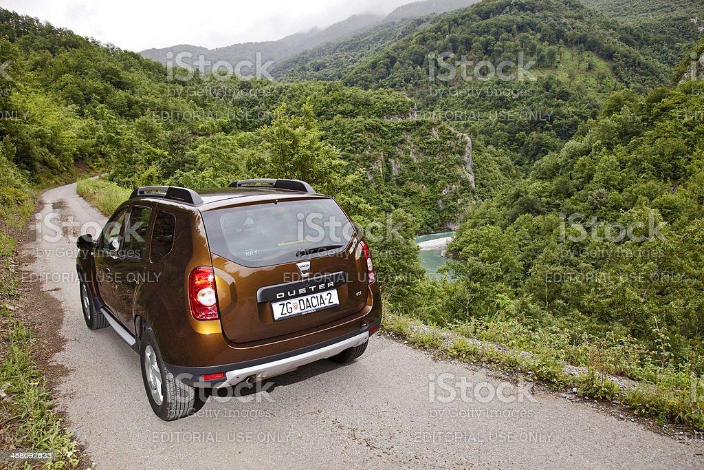 Dacia Duster on mountin road royalty-free stock photo