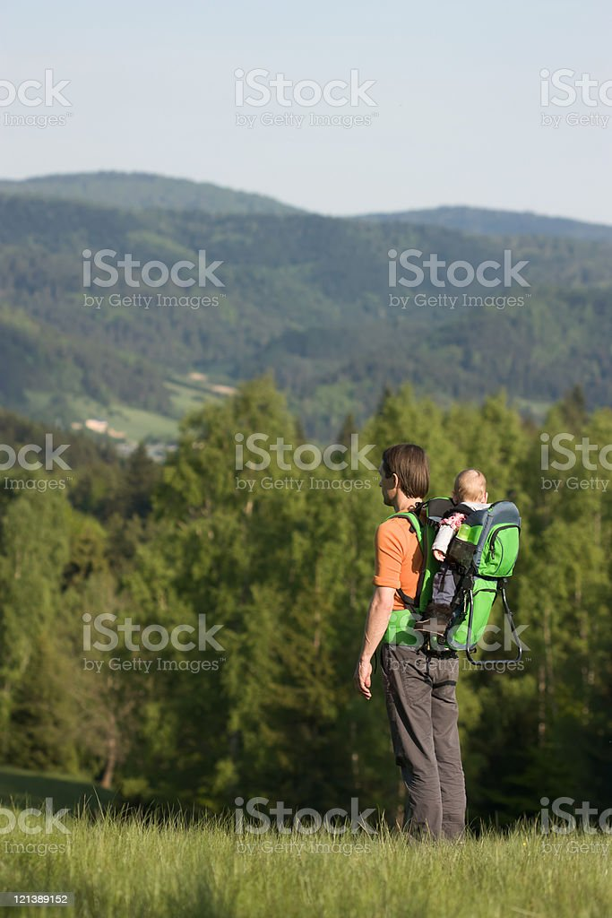 Dad and Child in Hiking Baby Carrier royalty-free stock photo