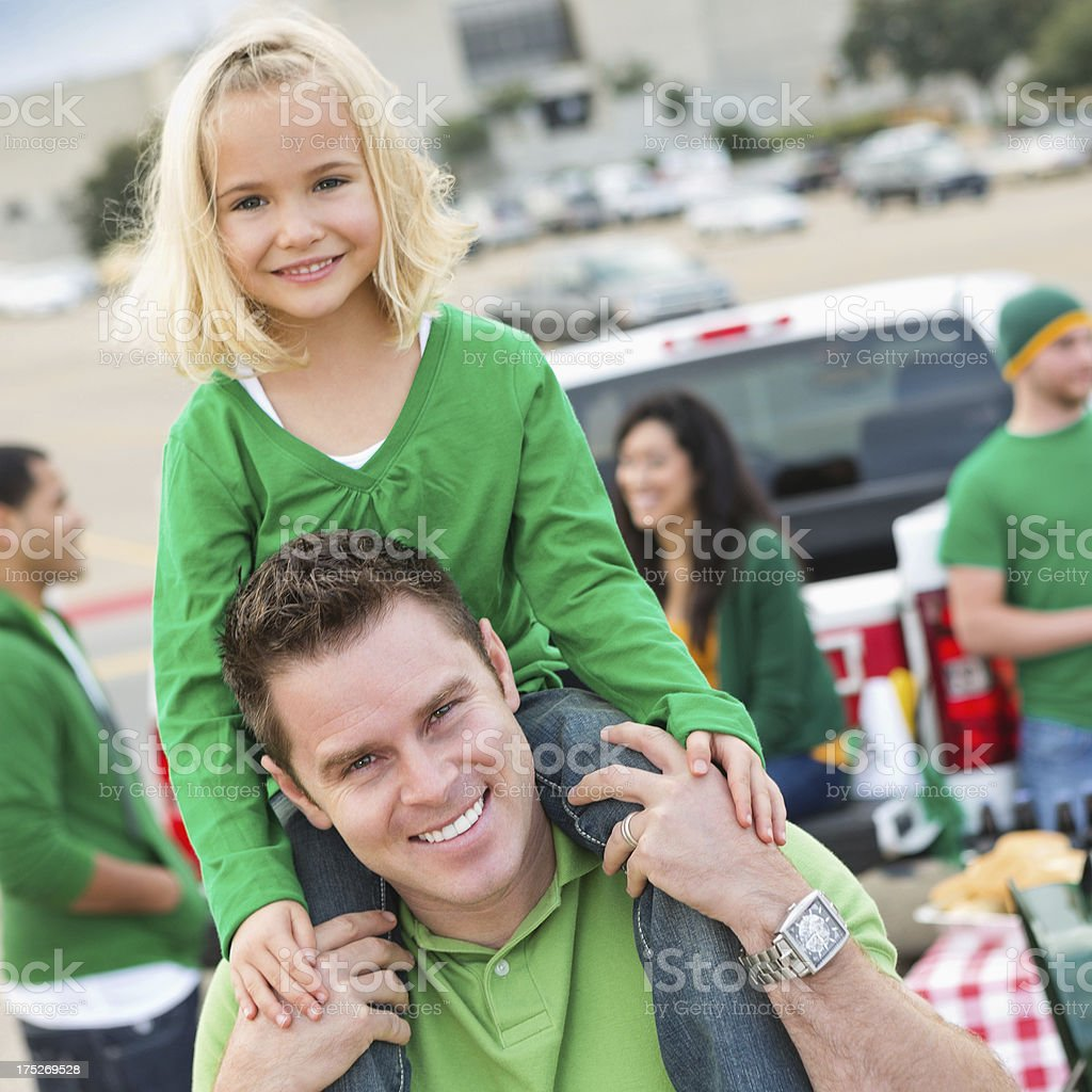 Dad and daughter at college football stadium tailgate party royalty-free stock photo