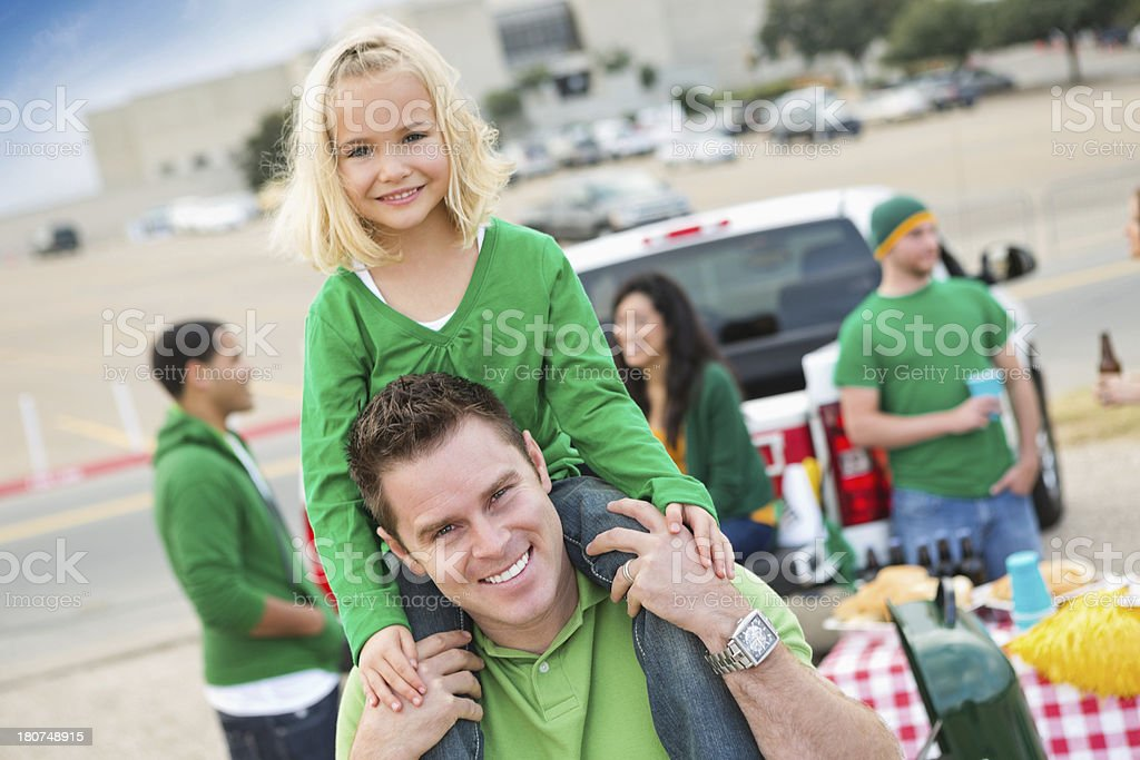 Dad and daughter spending time together at tailgate party royalty-free stock photo