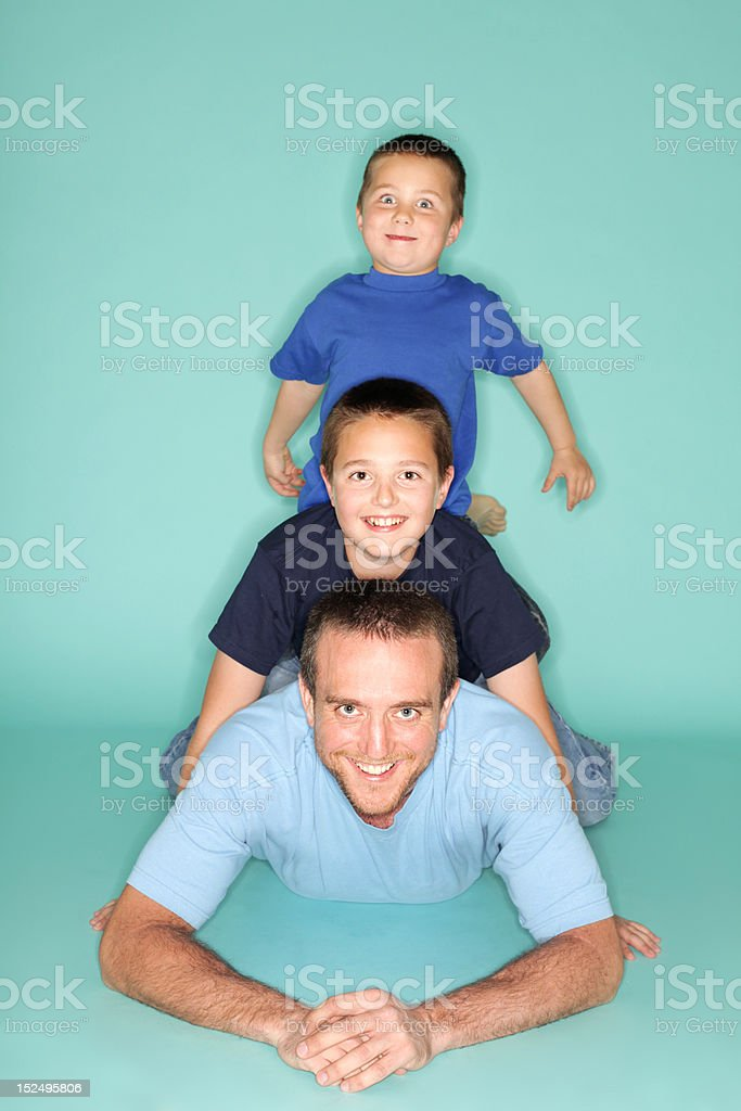 Dad and his boys on the floor royalty-free stock photo