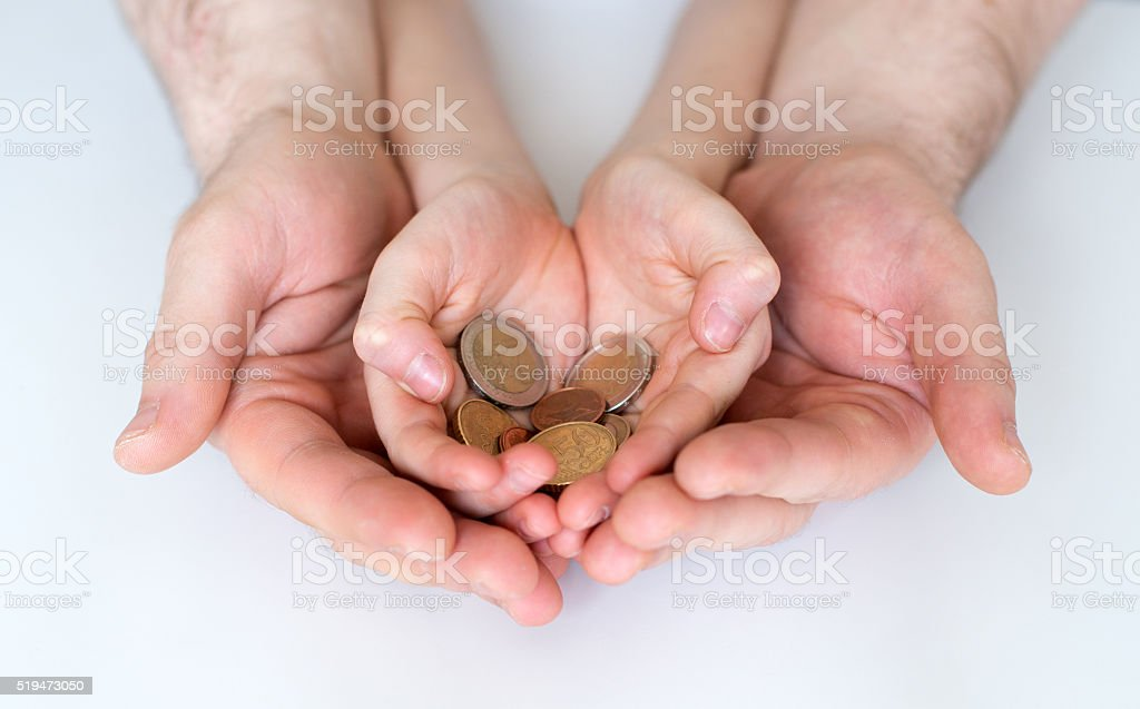 Dad and his daughter holding euro coins. stock photo