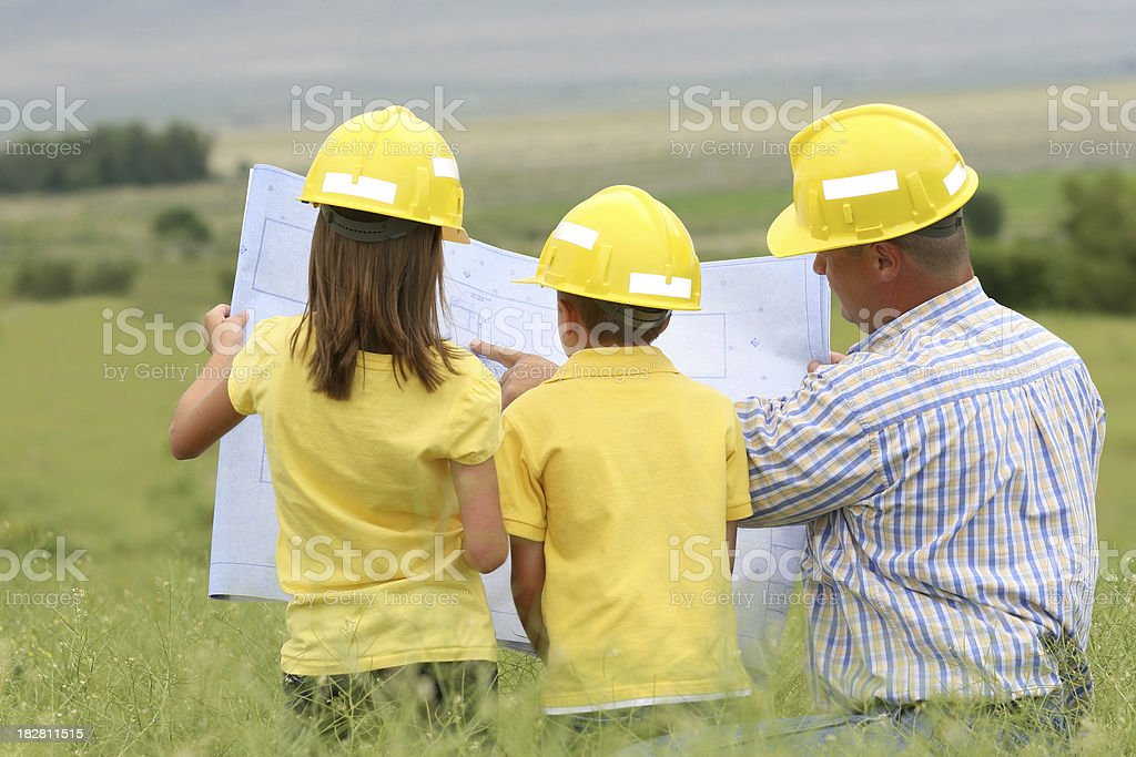 Dad and Kids Planning their Dream House stock photo